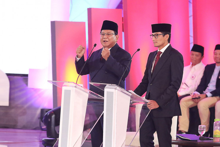 Presidential candidates Prabowo Subianto-Sandiaga Uno are on stage during the first candidate debate on Jan. 17.