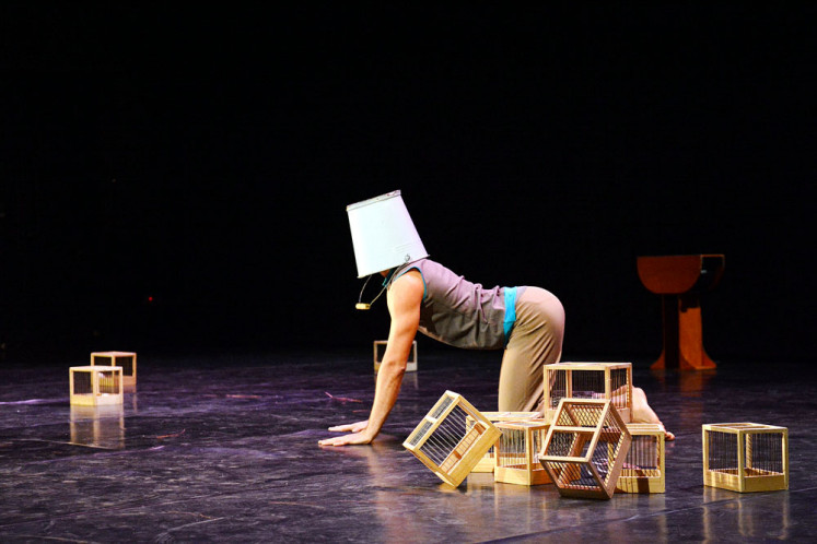 Bucket-head: The Flying Cow dance performance on Jan. 12 presents absurd yet amusing moments that are met with rapturous laughter from the audience.
