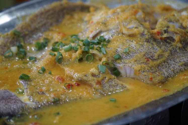'Ikan bumbu nyonya' at Aroma Sop Seafood in Muara Karang, North Jakarta.