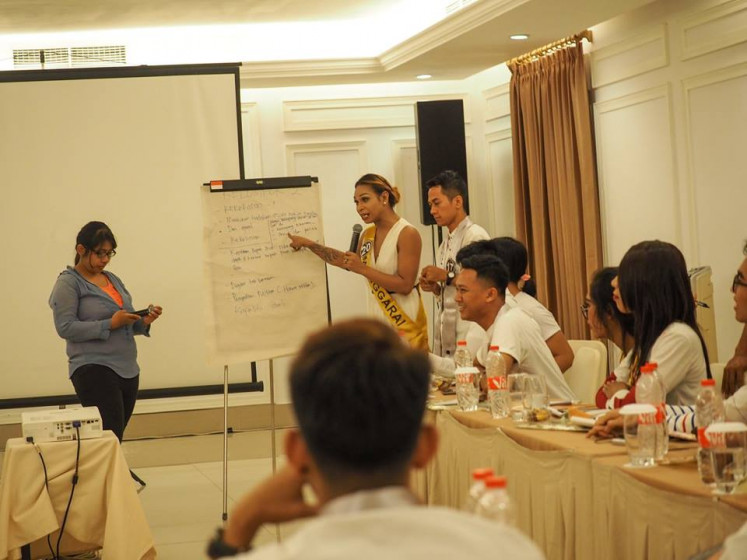 Knowledge to empower: The finalists receive training on LGBT rights during the pageant's quarantine program in October 2018.