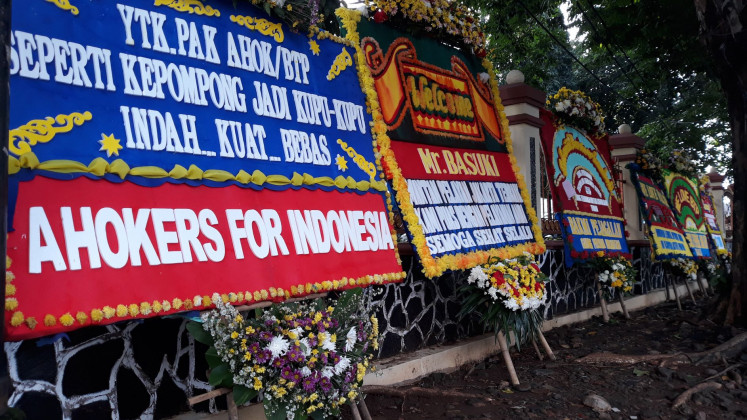 Flower boards with messages supporting former Jakarta governor Basuki