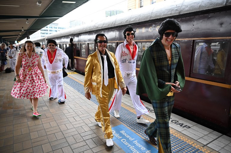 Elvis fans arrive at Central station before boarding a train to The Parkes Elvis Festival, in Sydney on January 10, 2019.