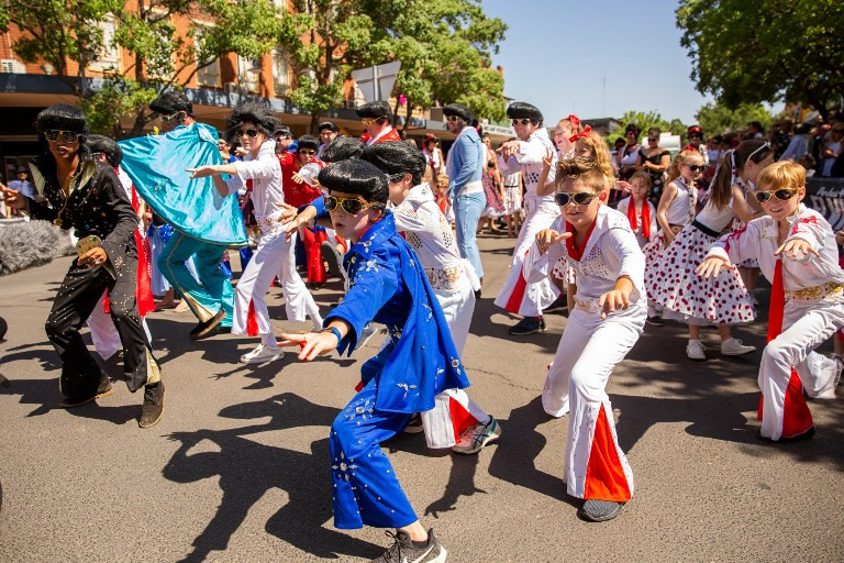 This handout photo taken on January 12, 2019 and released by the Parkes Elvis Festival shows children dressed as Elvis dancing in the street during the 2019 Parkes Elvis Festival in Parkes, some 300 kilometers west of Sydney in outback Australia. Once a year Parkes, a sleepy mining town in rural Australia, explodes into color and song -- a veritable Graceland in the outback hosting a five-day extravaganza to celebrate 'the King'.