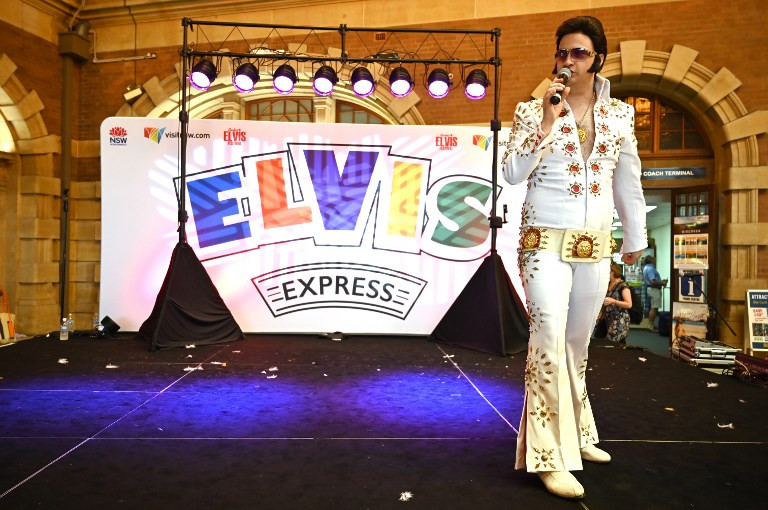 This photo taken on January 10, 2019 shows an Elvis fan performing at Central Station in Sydney before boarding a train to the Parkes Elvis Festival.