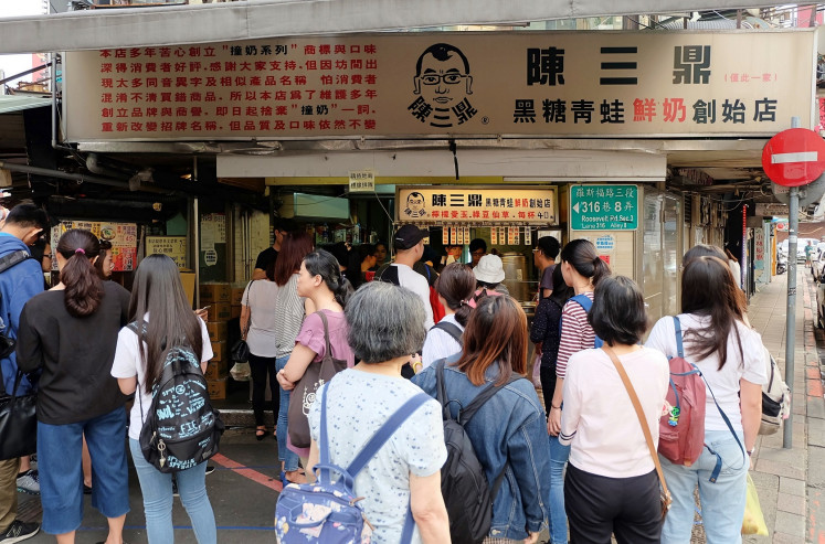 Worth the wait: Located in Taipei's Gongguan district, Chen San Ding attracts a large number of local and foreign customers who are looking to taste its signature fresh milk with tapioca pearls and brown sugar.
