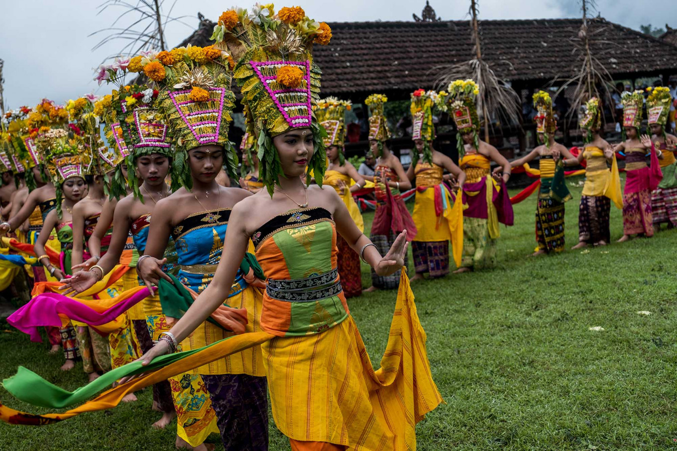 Dance across the village: The rejang dancers begin their performance from Bale Gede to Jasri village's temple yard. JP/Agung Parameswara