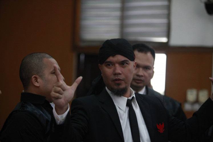 Musician Ahmad Dhani makes a hand gesture after he listens to the verdict that sentenced him to 18 months' imprisonment at South Jakarta District Court on Jan. 28.