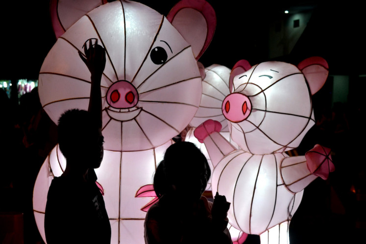 Pig-shaped lanterns are seen amid Chinese New Year festivities in Surakarta, welcoming the Year of the Pig
