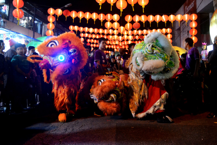 A barongsai (lion dance) performance entertains visitors at a lantern festival to celebrate Chinese New Year in Surakarta, Central Java.