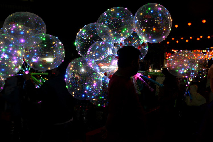 Glittering balloons are for sale at the lantern festival to celebrate Chinese New Year in Surakarta, Central Java