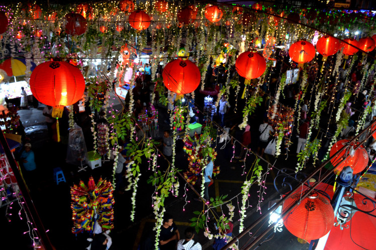 Around 5,000 lanterns are lit in the city center of Surakarta to celebrate Chinese New Year.