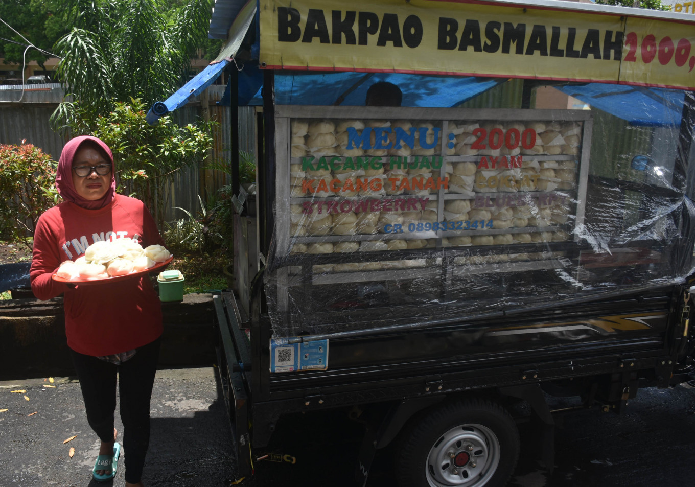 'Bakpao' (steamed buns) were among the food distributed to the orphanage's residents.