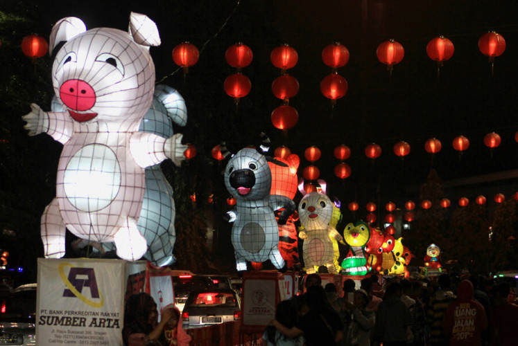 Lanterns depicting 12 Chinese zodiac signs line up along Jl. Jend. Sudirman in Surakarta, Central Java