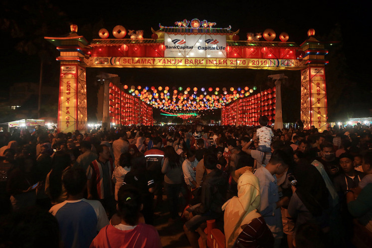 Hundreds of people crowd the Pasar Gede area near a gigantic gate built to celebrate Chinese New Year in Surakarta, Central Java.
