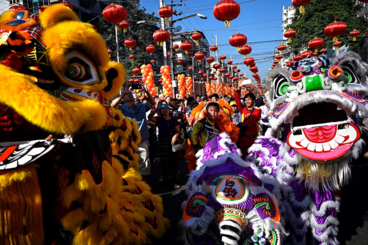 Lion dancers perform during Lunar New Year celebrations in Yangon on Feb. 5, 2019.