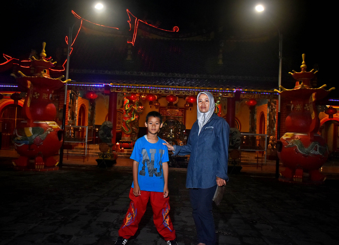Lusi Hernalisa poses with her 11-year-old son Chalvine before the latter starts training at the temple. JP/Aman Rochman
