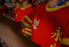 The Garuda Pancasila national logo is printed on the uniforms. JP/Aman Rochman