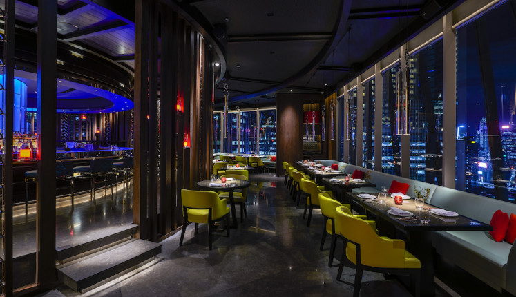 Main dining room at night at Hakkasan Jakarta