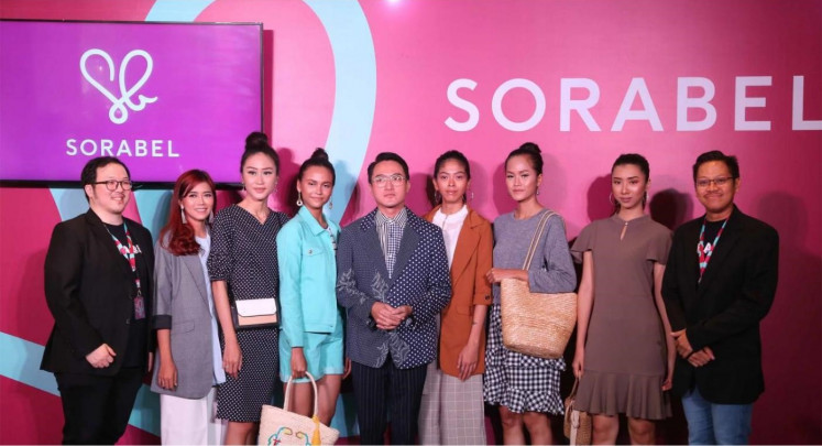 "Be Fashionable Forever: Jeffrey Yuwono (left), Barli Asmara (center) and Lingga Madu (right) pose for a photograph with models featuring fashion products offered by Sorabel. By launching its ""Be Fashionable Forever"" campaign, Sorabel urges ""sista"" to keep looking fresh and fun by wearing the latest and best quality clothes. ""Be Fashionable Forever"" also means empowering ""sista"" to always be confident inside and out."