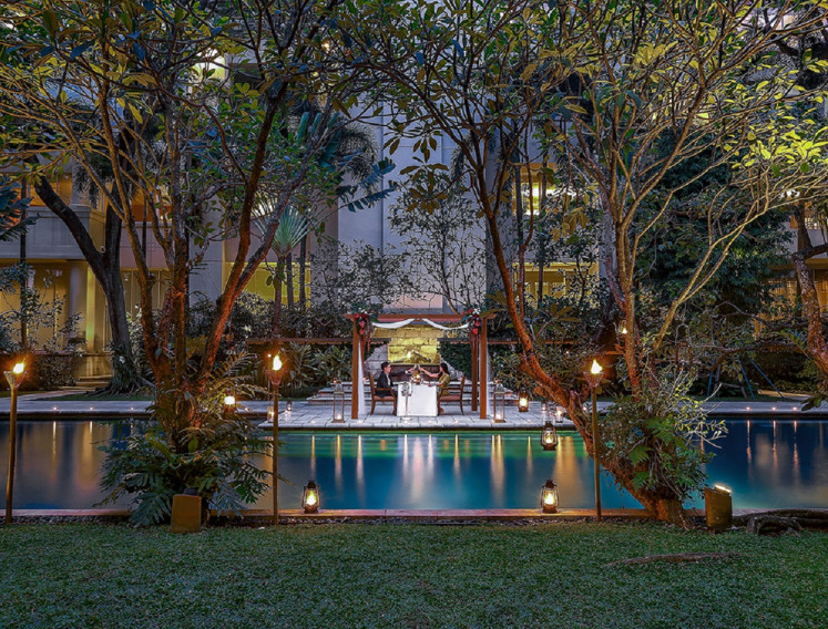 Romantic Cabana Dinner at the The Dharmawangsa Jakarta's Pool Garden on Valentine's day offers a seven-course set menu