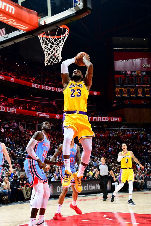 Triple for James but Lakers stumble; Warriors roll on