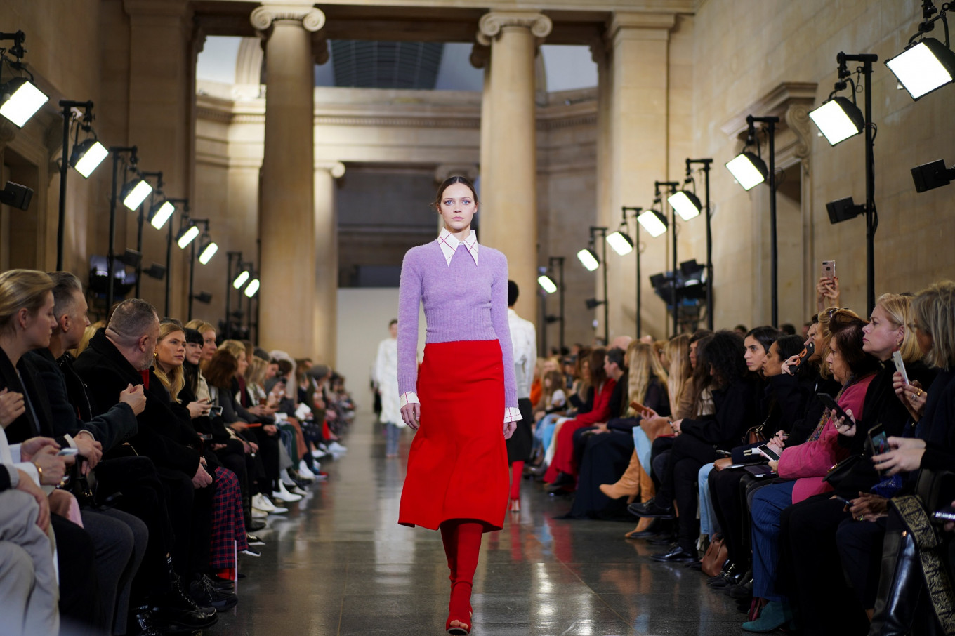 Beckham looks to '70s, Westwood turns catwalk into protest