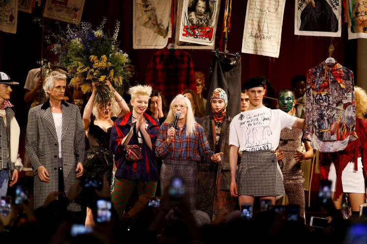 Designer Vivienne Westwood on stage with models following her catwalk show at London Fashion Week Women's A/W19 in London, Britain February 17, 2019.
