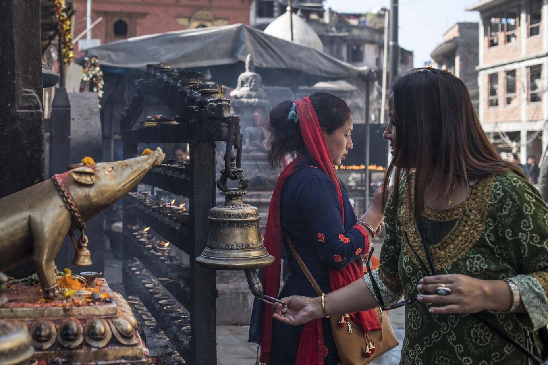 Locals pray at a small temple in Kathmandu. JP/Rosa Panggabean