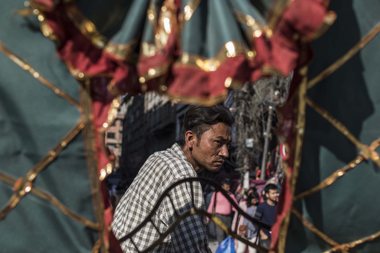 A rickshaw driver awaits passengers at Thamel, Kathmandu. JP/Rosa Panggabean