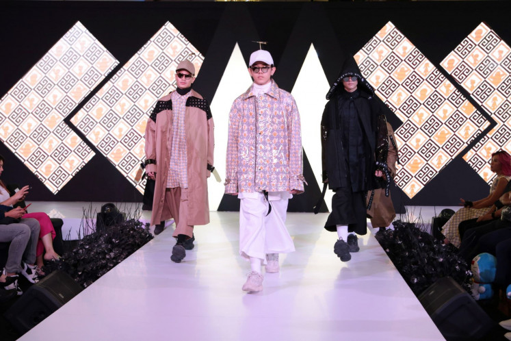 Dark wings: Men's looks from Ivan Gunawan's Kuroba collection are featured at Modo 2019.