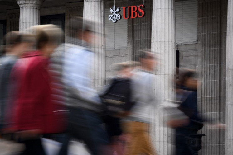 France fines Swiss bank UBS record 3.7 bn euros in tax fraud case