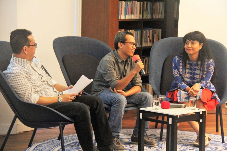 Book talk: Eka Kurniawan (center) is joined by philosophy lecturer Saras Dewi (right) and history lecturer Bondan Kanumoyoso for a panel discussion on his writing.