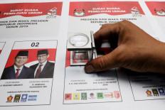 A staff is making sure there is no defect in the ballot papers. JP/Dhoni Setiawan