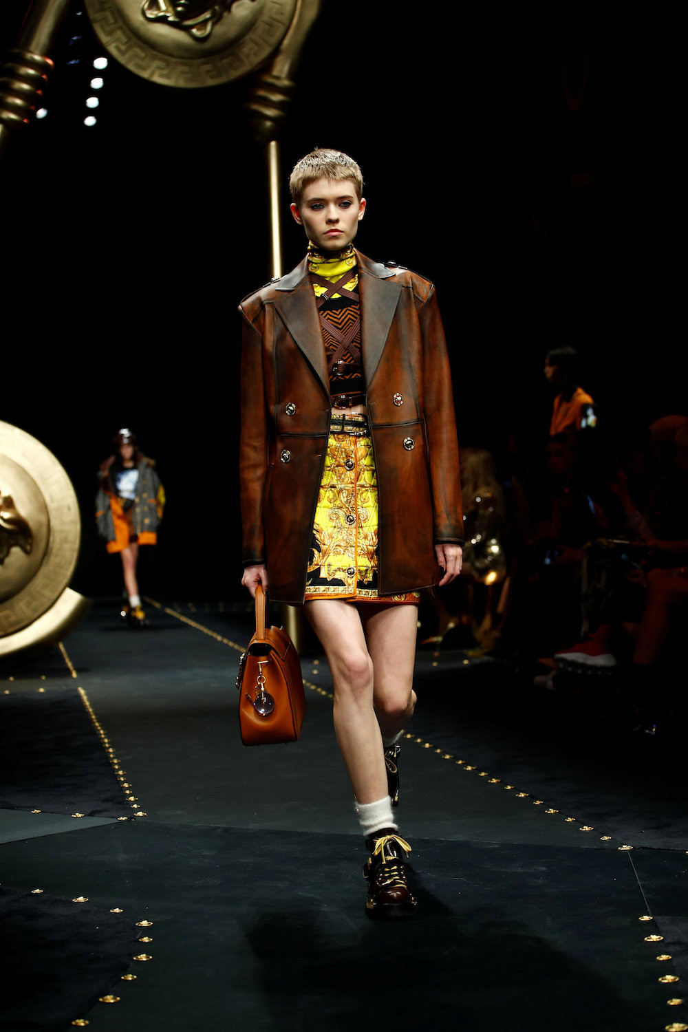 ede34e222b A model presents a creation by Versace during the Milan Fashion Week in  Milan