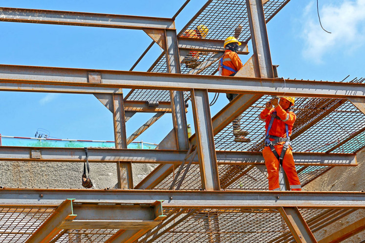 Watch your step: Workers stand on scaffolding above a giant tunnel built for the Jakarta-Bandung high-speed railway project in Walini, West Bandung regency, West Java, on Feb. 21.