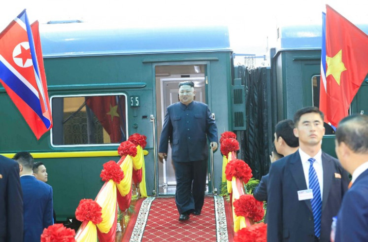 North Korean leader Kim Jong Un (C) arrives at the Dong Dang railway station in Dong Dang, Lang Son province, on February 26, 2019, to attend the second US-North Korea summit. North Korean leader Kim Jong Un crossed into Vietnam on February 26 after a marathon train journey for a second summit showdown with Donald Trump, with the world looking for concrete progress over the North's nuclear program.