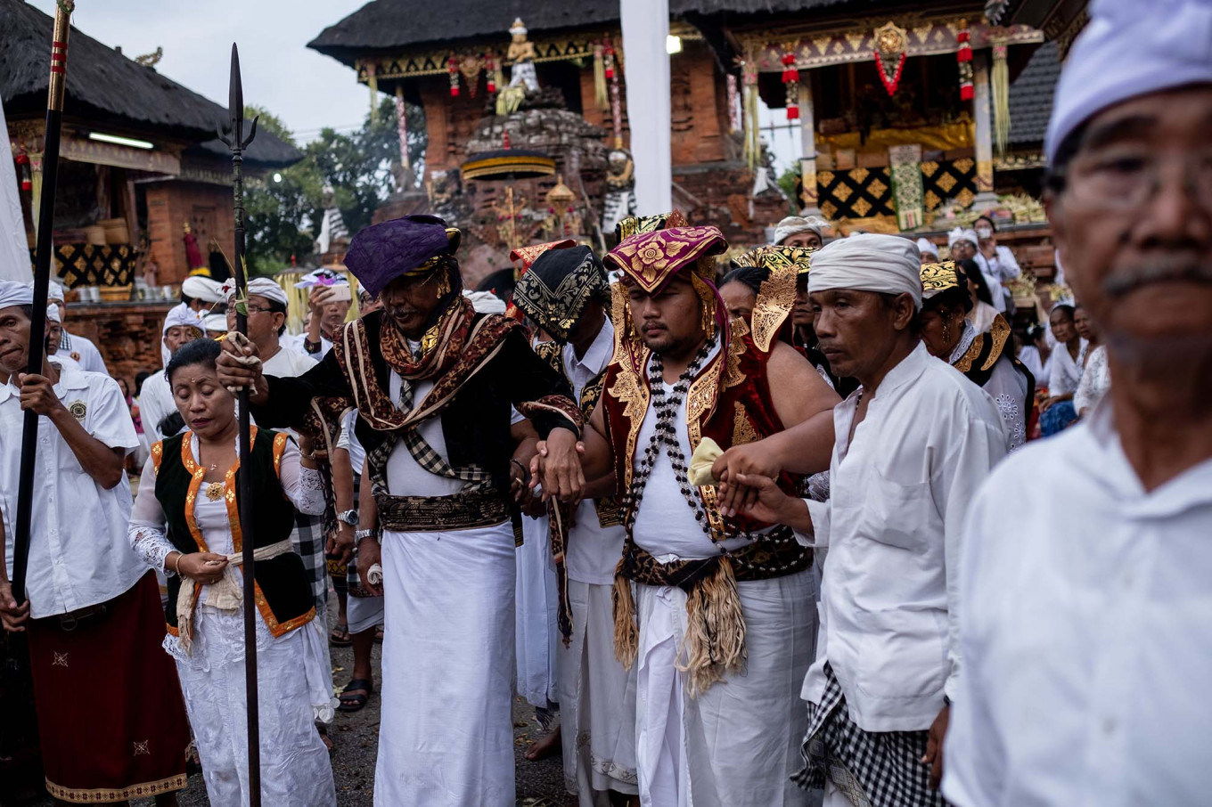 A Balinese man wears an ancient costume during Ngerebong while holding a spear. JP/Agung Parameswara