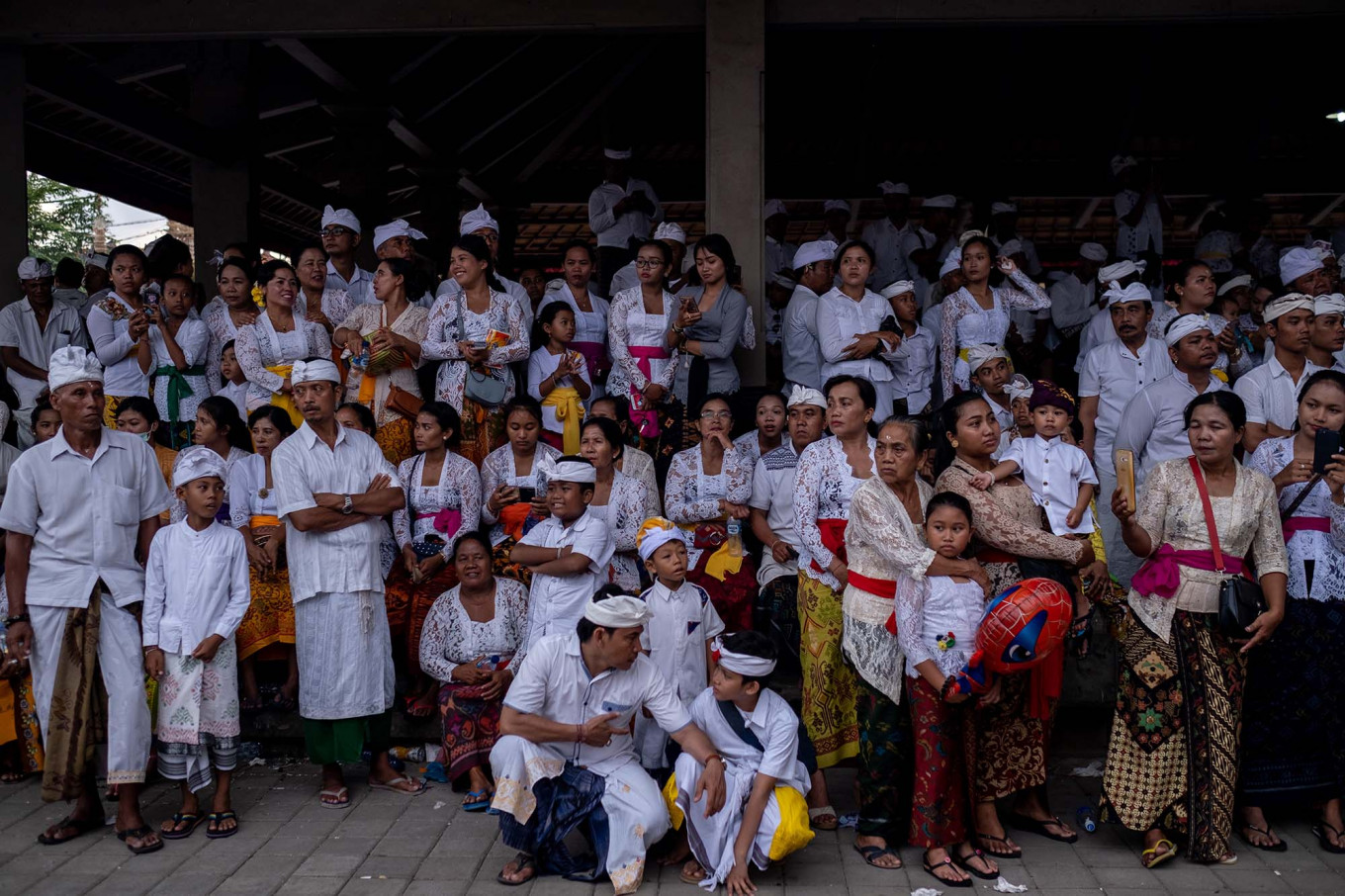 Balinese people gather during Ngerebong at the Petilan temple on Jan. 13 in Denpasar, Bali. JP/Agung Parameswara