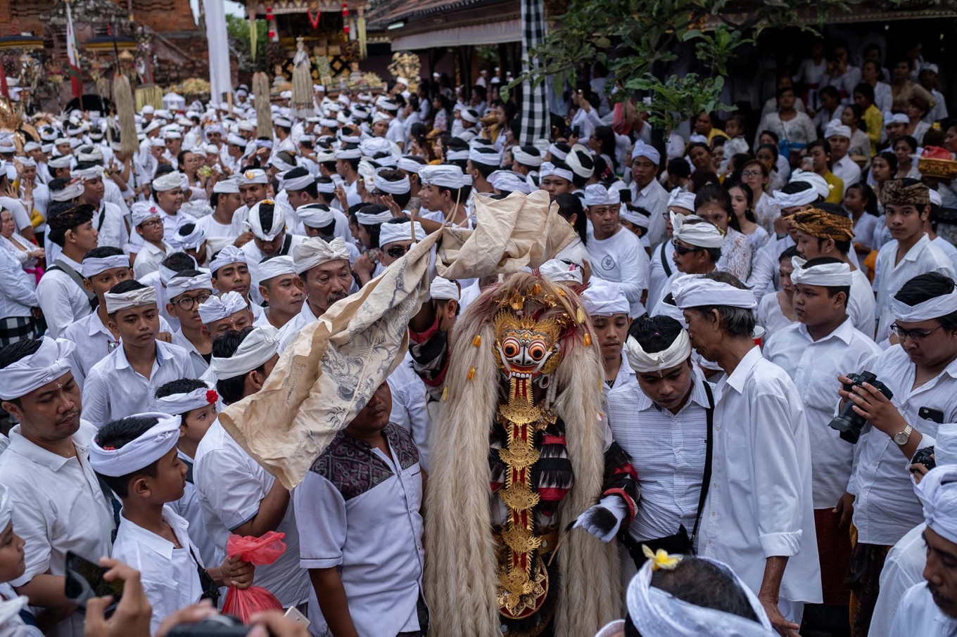 A Balinese man unconsciously dances while wearing a sacred Rangda (golden-haired and fanged figures usually representing the goddess Durgha, known as Shiva's wife) during Ngerebong. JP/Agung Parameswara