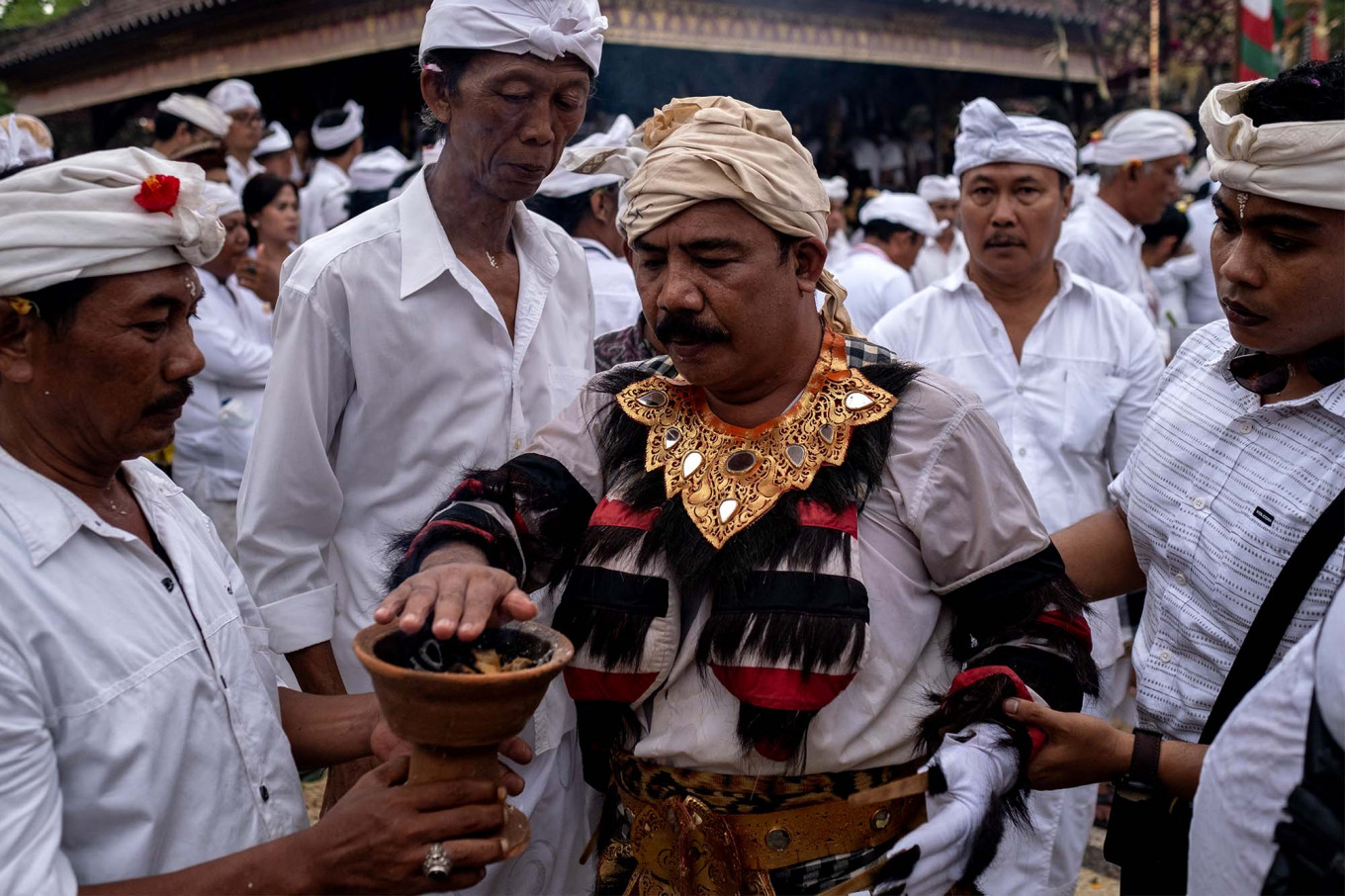 A Balinese leader touches fire while wearing a sacred Rangda. JP/Agung Parameswara