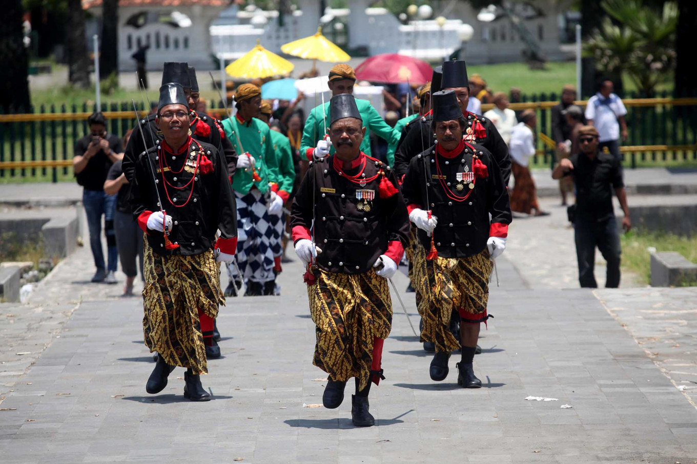 The guardians: Palace guards escort the labuhan ritual objects to the Parang Kusumo Beach. JP/Boy T Harjanto
