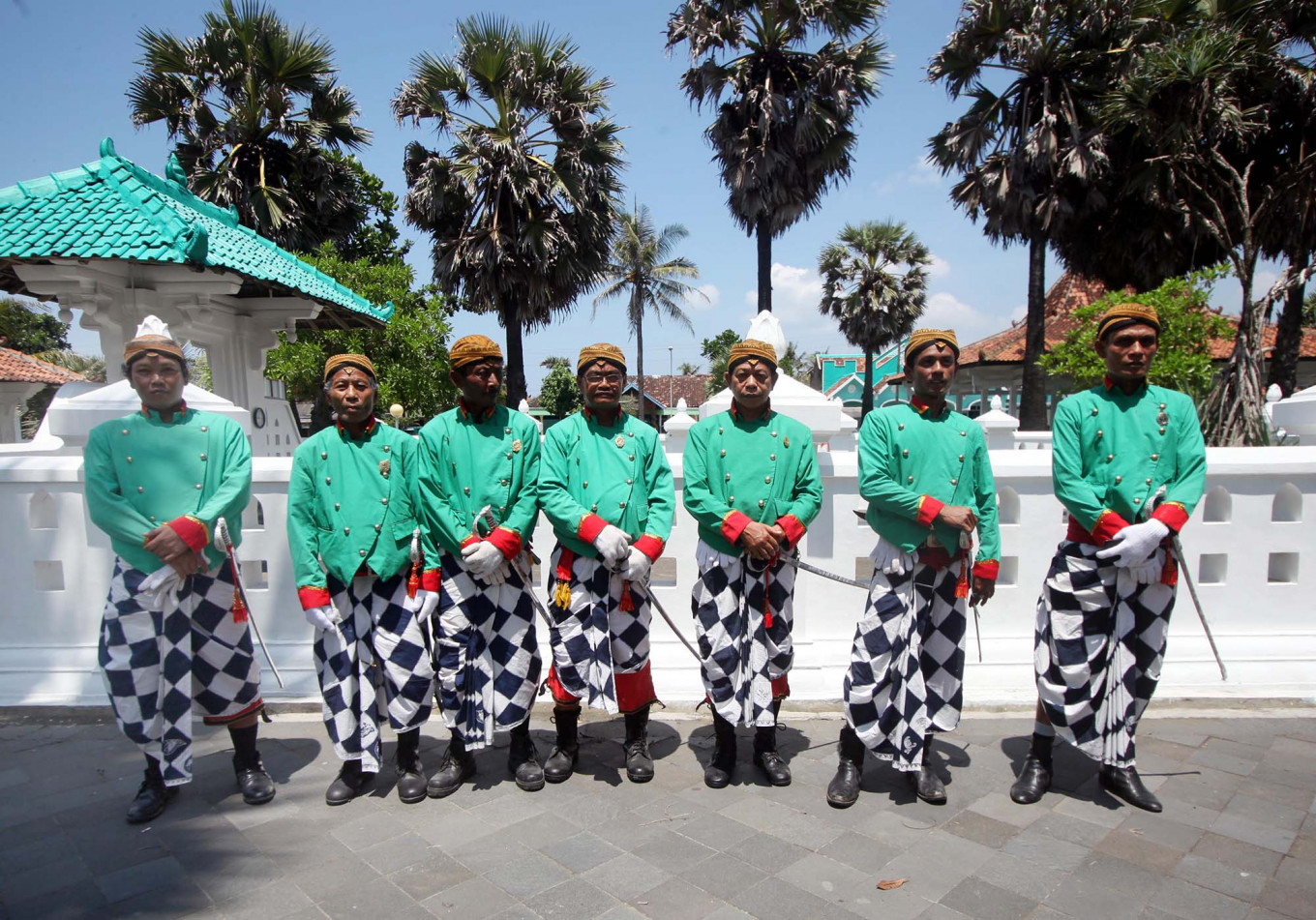 Ready to commence: Kasunanan Surakarta Palace guards pose before the masonry wall of the tomb of Panembahan Senopati, the founder of the Mataram Sultanate. JP/Boy T Harjanto