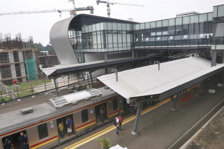 A Commuter Line train stands at Cisauk Station in Tangerang regency.