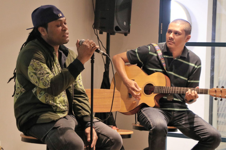 From the heart: Singer Michael Jakarimilena (left) of Indonesian Idol fame often sings songs about Papua during his shows.
