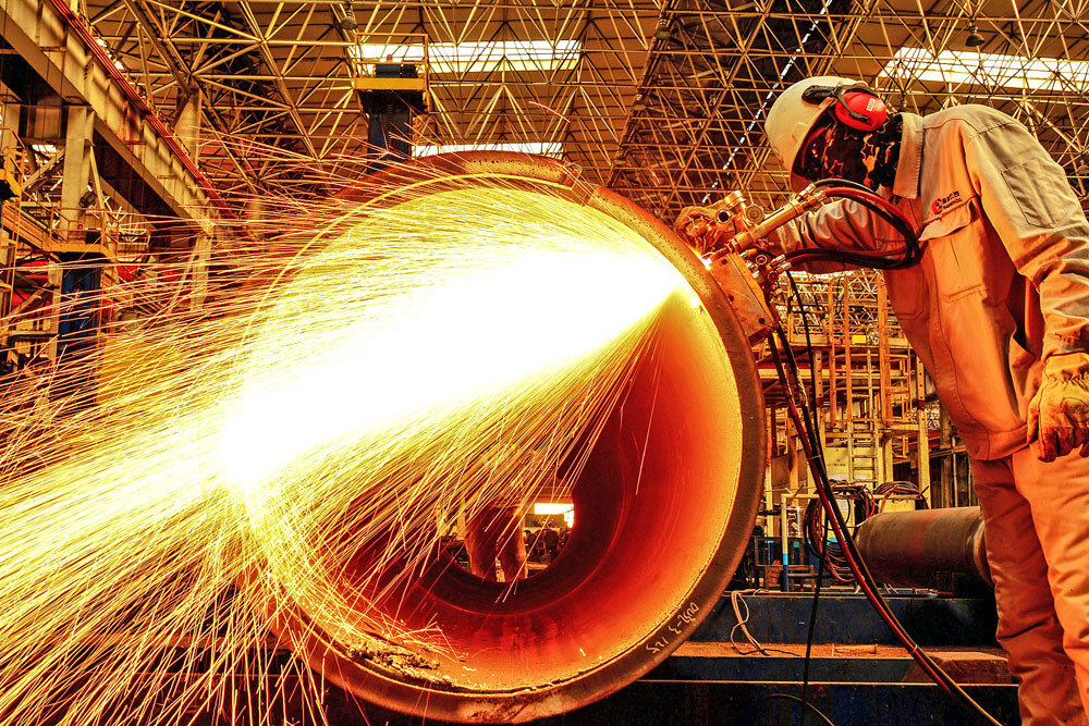China's factory activity rises to near-decade high in October: Caixin PMI