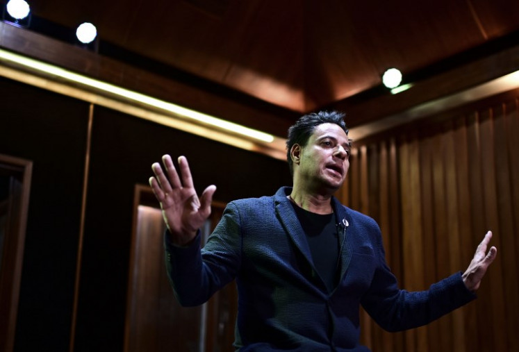 Venezuelan singer Horacio Blanco, leader of ska music group Desorden Publico, gestures as he speaks during an interview at a recording studio in Caracas, on March 01, 2019.