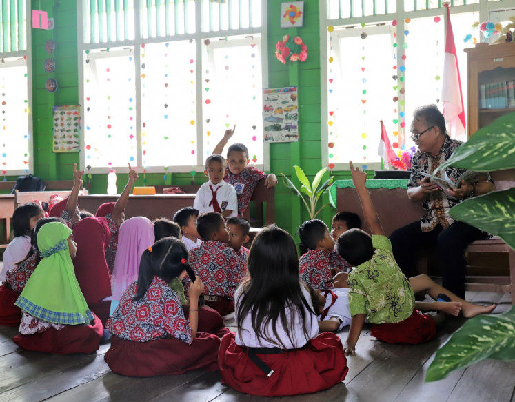 Story time: Kuleh Lenjau reads a story to the class; a favorite time in the school day