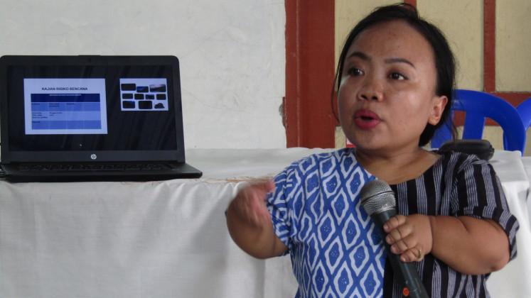 Anggiasari Puji Aryatie, 39, a NasDem Party legislative candidate, gives a presentation about disaster risks in  kampung Bausasran in Yogyakarta.