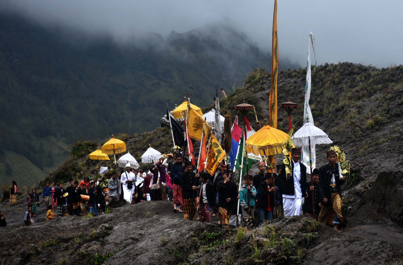Tengger people carry offerings, heirlooms and temple ornaments during the Melasti ceremony on Sunday.