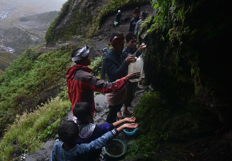 Tengger people take the holy water during the Melasti ritual on Sunday.